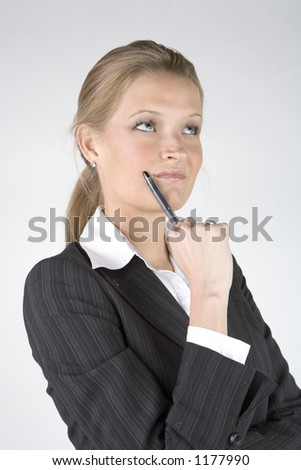 pretty business woman thinking - stock photo