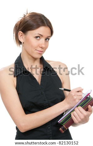 Pretty business woman thinking, holding stack of books, notebook, copy-book and and writing ready for college classes on a white background - stock photo