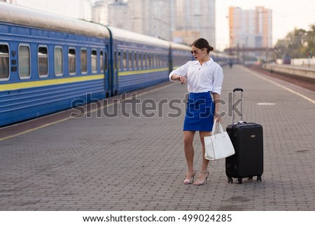 Pretty business woman waiting at the train station