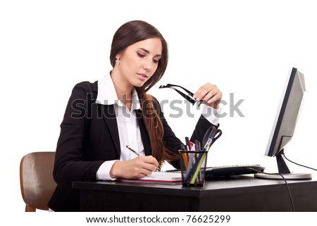 pretty business woman working at office - stock photo
