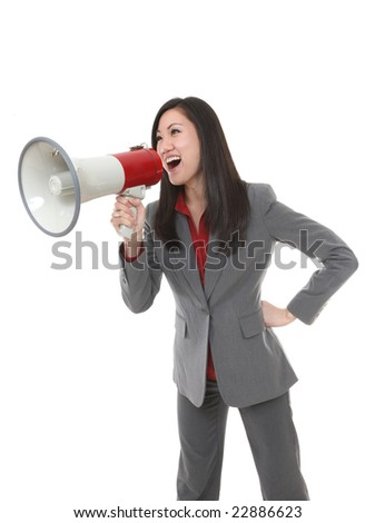 Pretty business woman yelling through megaphone