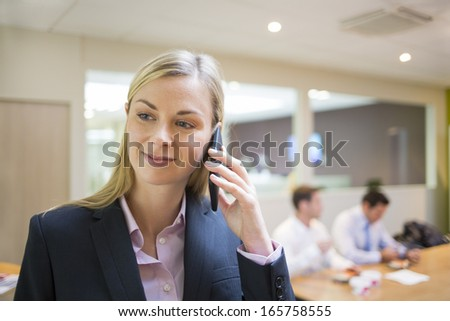 Pretty businesswoman at mobile phone, Breakfast colleague background - stock photo