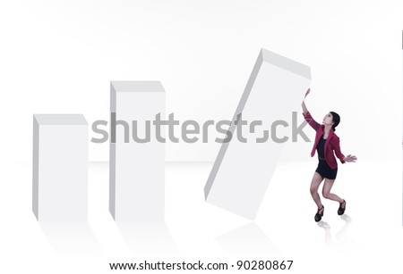 Pretty businesswoman holding on to a bar chart isolated on white