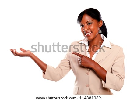 Pretty businesswoman looking at you pointing right on isolated background - stock photo