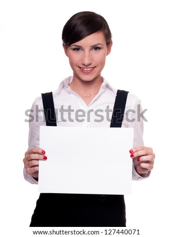 Pretty businesswoman smiling holding blank piece of paper isolated on white - stock photo