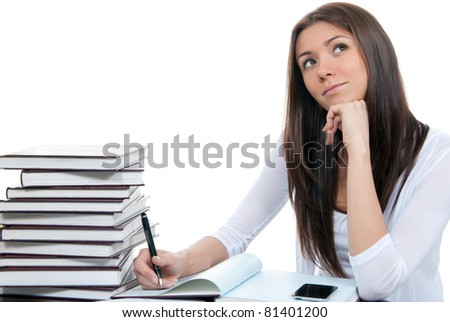 Pretty businesswoman thinking, looking up with laptop on the table and holding pen in hand at work office place on a white background - stock photo