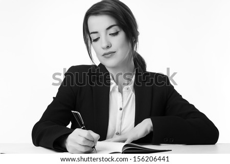 Pretty businesswoman working and and deep in thought - stock photo