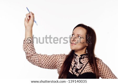 Pretty Businesswoman writing something on empty space - stock photo