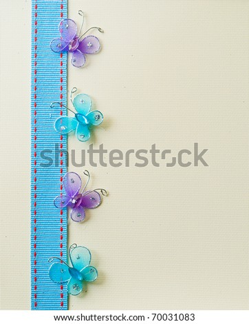 Pretty butterfly and ribbon background. - stock photo