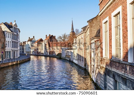 Pretty canal scene with beautiful architecture in Bruges Belgium. - stock photo
