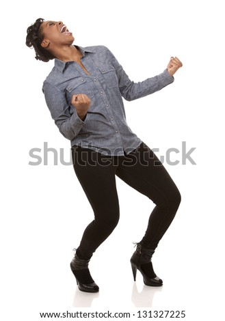 pretty casual black woman is very happy on white background - stock photo