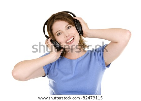 pretty casual brunette is listening to music on white background