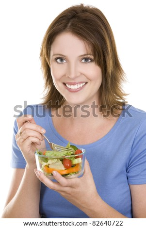 pretty casual brunette wearing blue top eating salad
