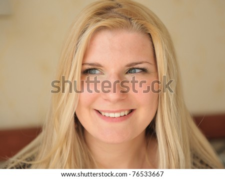 Pretty casual smiling woman portrait indoors