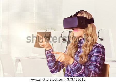 Pretty casual worker using oculus rift against computers and headsets - stock photo
