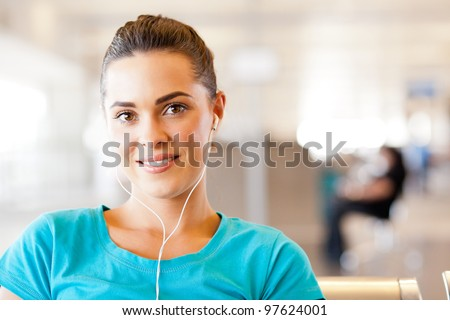pretty casual young woman with earphones listening music - stock photo