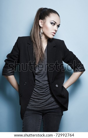 pretty caucasian adult posing in studio - stock photo