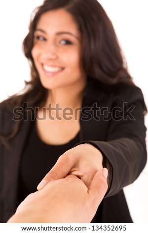 Pretty caucasian business woman shaking hands - selective focus on hand - stock photo