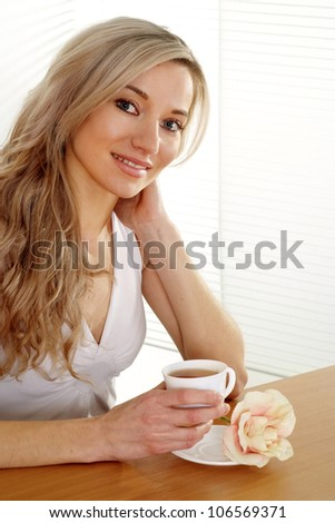 Pretty Caucasian business woman sitting on a light background