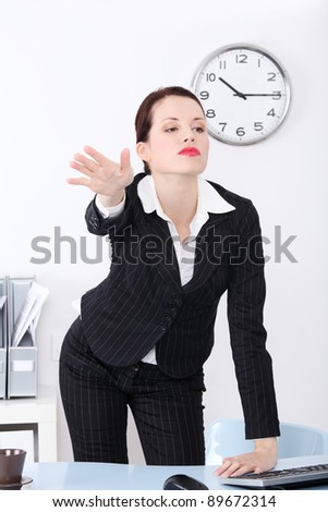 Pretty caucasian businesswoman firing her worker in the office. - stock photo