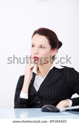 Pretty caucasian businesswoman smoking a electronic cigarette in the office. - stock photo