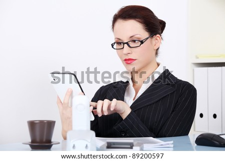 Pretty caucasian businesswoman using a tablet in the office. - stock photo