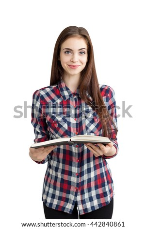 Pretty caucasian girl in casual outfit, isolated on white background, holding open book. Education concept - stock photo