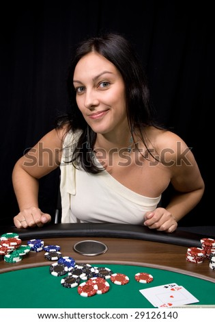 Pretty caucasian girl shows two aces in casino poker and win!