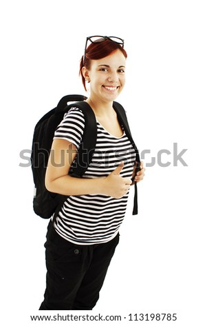 Pretty caucasian girl with backpack showing her thumb-up. Isolated on white background