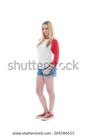 pretty caucasian girl with long blonde hair, wearing casual shirt, shorts and sneakers. standing pose against a isolated white background. - stock photo