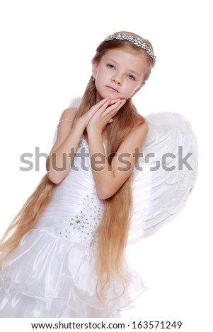 Pretty caucasian little angel looking up and praying gratefully  - stock photo