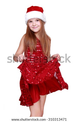 Pretty caucasian little girl dancing on Holiday theme/Beautiful little girl on Christmas - stock photo