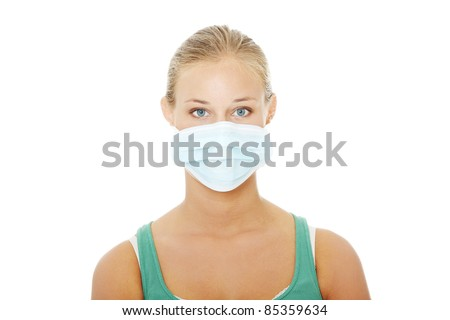 Pretty caucasian woman wearing a face mask to protect from viruses. Isolated on white background. - stock photo