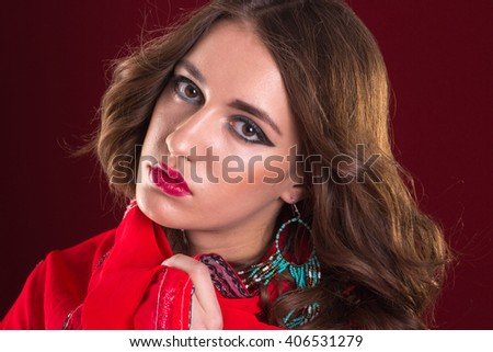 Pretty caucasian woman wearing in red indian sari close up portrait