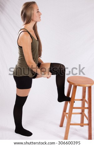 Pretty Caucasian woman with long hair wearing shorts and looking thoughtful