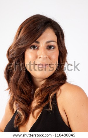 Pretty Caucasian woman with pleasing smile, looking at the camera with a friendly expression - stock photo