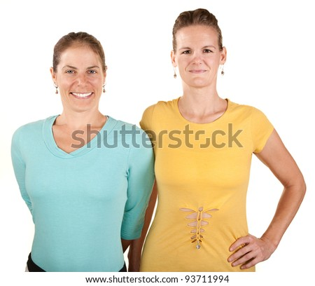 Pretty Caucasian women smiling over white background - stock photo