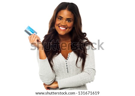 Pretty charming woman holding up a credit card. Isolated white background.
