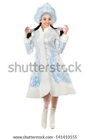 Pretty cheerful lady posing in a snow maiden costume. Isolated on white