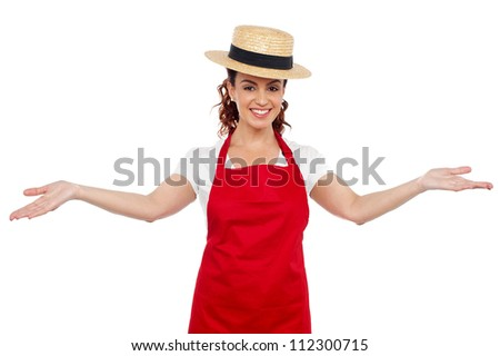 Pretty chef welcoming you with her arms stretched isolated over white background - stock photo