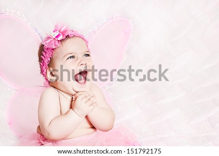Pretty child girl in butterfly costume on pink - stock photo