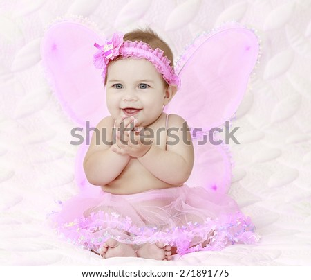 Pretty child girl in butterfly pink costume - stock photo