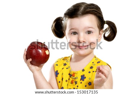 pretty child holding a red apple in her hands on white - stock photo
