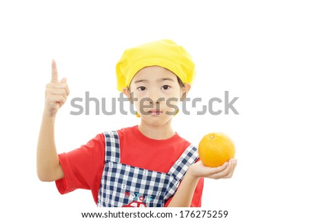 Pretty child holding fruit in her hands on white  - stock photo