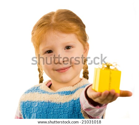 Pretty child holding small giftbox on her palm while stretching it to you - stock photo