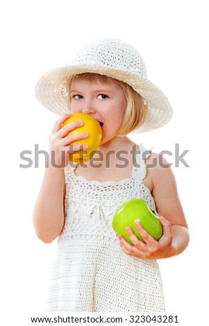 Pretty child with apples on the white background - stock photo