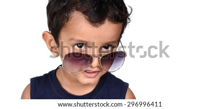 Pretty child with sunglasses. Beauty smiling child boy in sunglasses gesturing white isolated on white. - stock photo