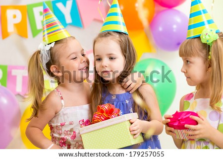 pretty children giving gifts on birthday party - stock photo