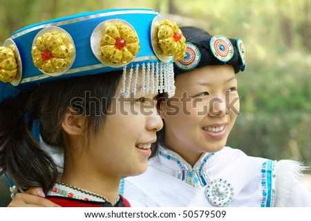 Pretty Chinese girl in the traditional clothes of the Naxi minority culture - stock photo