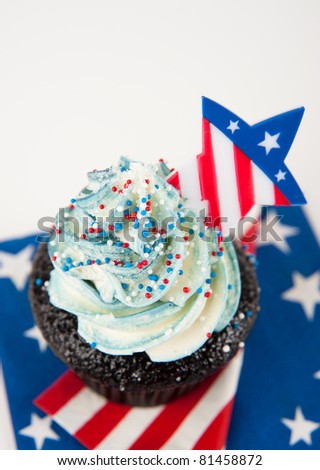 Pretty Chocolate Cupcake with Blue Frosting and Star Decorations for Independence Day